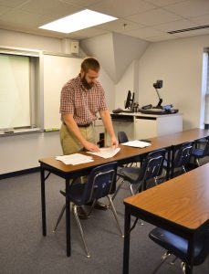 Craig prepares materials for class.