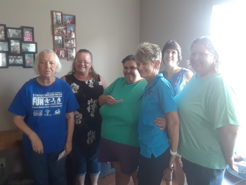 The accounting department poses with several individuals in Community Living